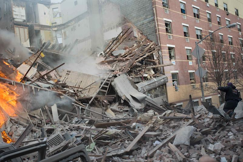 Emergency workers respond to the scene of an explosion that leveled two apartment buildings in the East Harlem neighborhood of New York, Wednesday, March 12, 2014. Con Edison spokesman Bob McGee says a resident from a building adjacent to the two that collapsed reported that he smelled gas inside his apartment, but thought the odor could be coming from outside. (AP Photo/Jeremy Sailing)