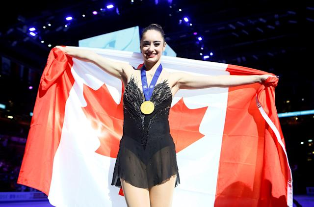 Figure Skating - World Figure Skating Championships - The Mediolanum Forum, Milan, Italy - March 23, 2018 Canada's Kaetlyn Osmond poses as she celebrates winning the gold medal after the Ladies Free Skating REUTERS/Alessandro Garofalo