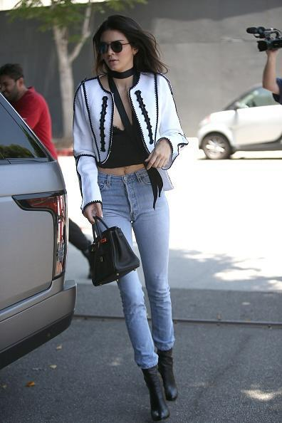 <p>As per usual Kendall is rocking her signature minimal style. Pairing casual skinny jeans with a chic detailed jacket and skinny scarf. Her perfection is unfair. [<i>Photo: Getty Images]</i></p>