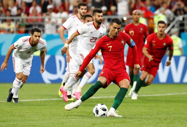 Soccer Football - World Cup - Group B - Iran vs Portugal - Mordovia Arena, Saransk, Russia - June 25, 2018 Portugal's Cristiano Ronaldo has a penalty saved by Iran's Alireza Beiranvand REUTERS/Murad Sezer