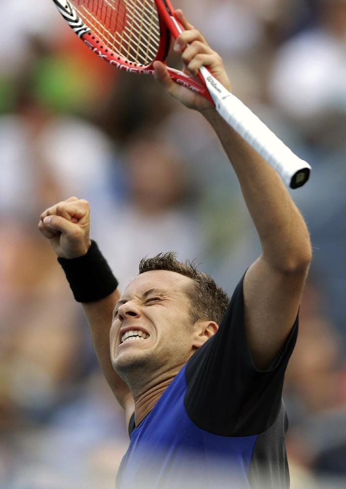 Philipp Kohlschreiber, of Germany, celebrates after beating John Isner during the third round of the 2013 U.S. Open tennis tournament, Saturday, Aug. 31, 2013, in New York. (AP Photo/Darron Cummings)