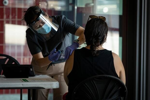 Toronto Public Health data shows that 77.6 per cent of eligible Torontonians are now vaccinated against COVID-19. (Evan Mitsui/CBC - image credit)