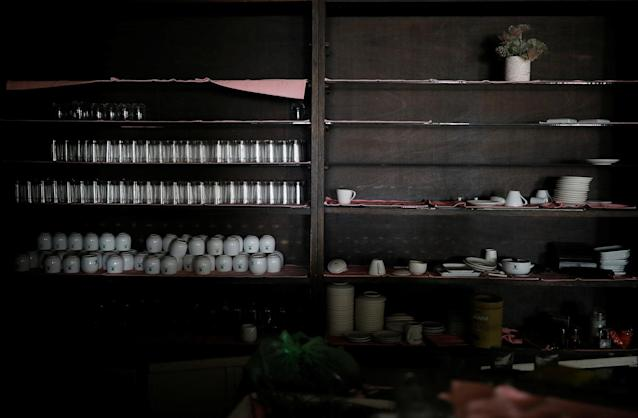 <p>Tableware lies on shelves at a restaurant of the abandoned Alps Ski Resort located near the demilitarized zone separating the two Koreas in Goseong, South Korea, Jan. 17, 2018. (Photo: Kim Hong-Ji/Reuters) </p>