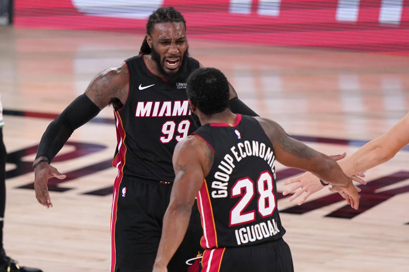 Miami Heat's Jae Crowder (99) and teammate Andre Iguodala (28) celebrate a basket during the second half of an NBA conference final playoff basketball game against the Boston Celtics Sunday, Sept. 27, 2020, in Lake Buena Vista, Fla. (AP Photo/Mark J. Terrill)