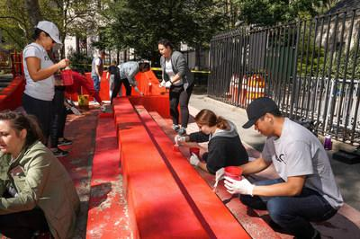 Diageo NA employees painting risers at Manhattan's Columbus Park with Partnerships for Parks.