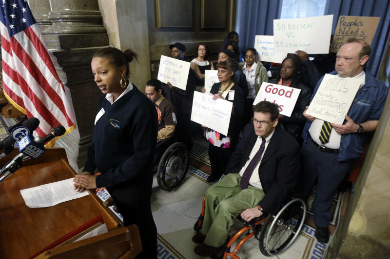 Wheelchair attendant Nikisha Watson,  left, speaks during a news conference, Monday, May 6, 2013, in Philadelphia. Wheelchair attendants at Philadelphia International Airport are alleging that defective equipment, lack of training and exposure to bodily fluids have led to unsafe working conditions. The employees of PrimeFlight transport disabled passengers throughout the airport. (AP Photo/Matt Rourke)