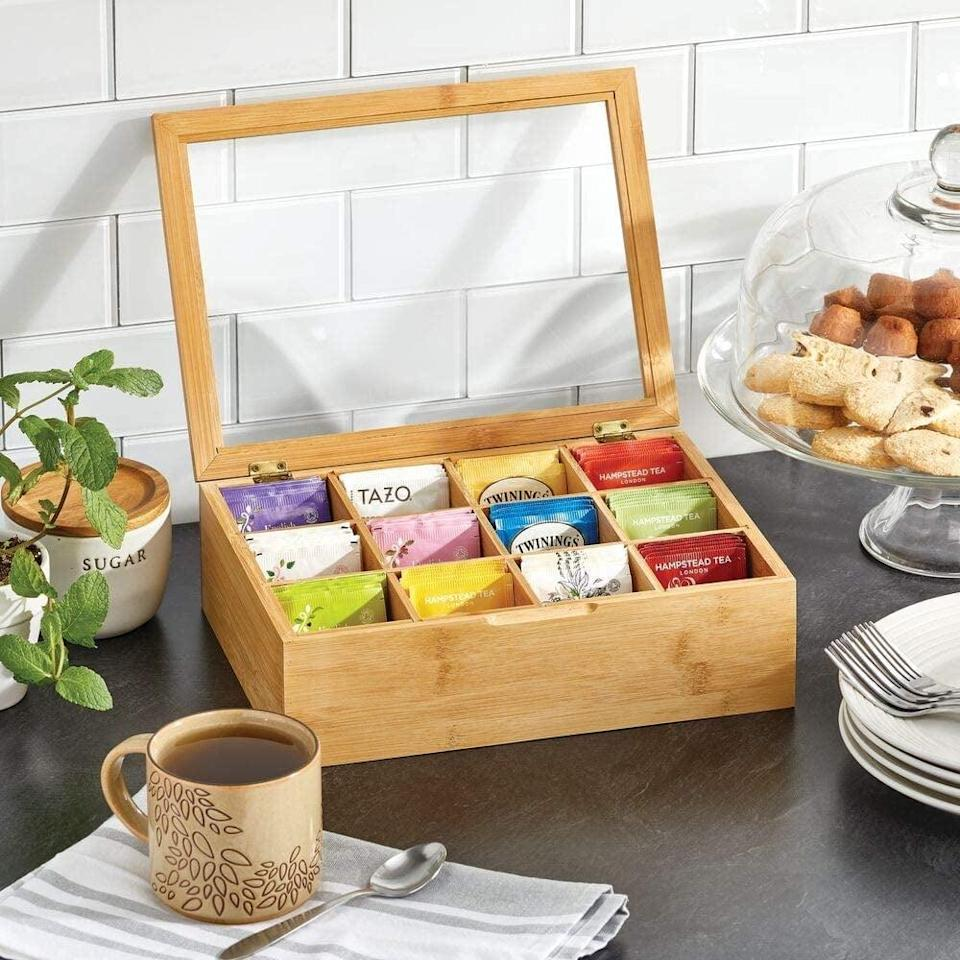 <p>A frequent tea drinker will be thrilled to receive this <span>Bamboo Tea Storage Organizer Box</span> ($29).</p>