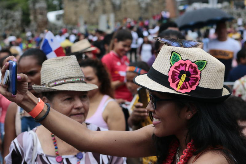 A woman takes a picture a butterfly that is standing on her hat, during the activities celebrating the 500 anniversary of the founding of Panama City, at the site of the ruins of Old Panama, Thursday, Aug. 15, 2019. The city was founded on August 15, 1519 by Spanish conquistador Pedro Arias Davila. On Jan. 28 1671, the Welsh pirate Henry Morgan attacked the city and destroyed it. The attack caused the city to be rebuilt a few kilometers to the west on a new site. (AP Photo/Eric Batista)