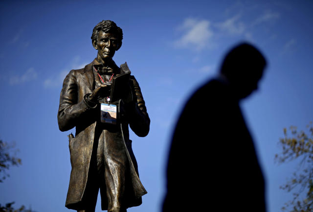 <p>A personalized Abraham Lincoln credential for Thursday's vice presidential debate hangs on a statue of Lincoln, Oct. 10, 2012, at Centre College in Danville, Ky. (AP Photo/David Goldman) </p>