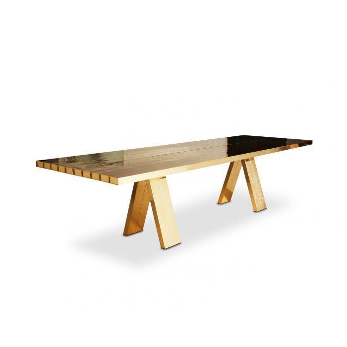 """<p>This super-shiny metal is making a comeback, in hardware, in lighting, and now in furniture, too, with pieces like the large-scale Mass dining table by <a href=""""https://www.tomdixon.net/en_gb/mass-dining-table-1.html"""" rel=""""nofollow noopener"""" target=""""_blank"""" data-ylk=""""slk:Tom Dixon"""" class=""""link rapid-noclick-resp"""">Tom Dixon</a>. </p>"""