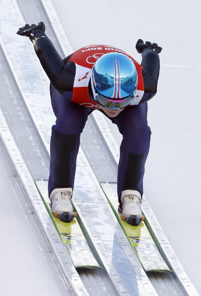 Germany's Carina Vogt speeds down the track during a women's ski jumping training session at the 2014 Winter Olympics, Saturday, Feb. 8, 2014, in Krasnaya Polyana, Russia. (AP Photo/Matthias Schrader)