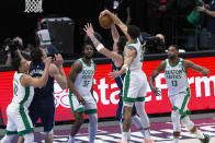 Boston Celtics forward Jayson Tatum (0) blocks Dallas Mavericks guard Luka Doncic (77) on a shot attempt during the first half of an NBA basketball game in Dallas, Tuesday, Feb. 23, 2021. (AP Photo/Sam Hodde)