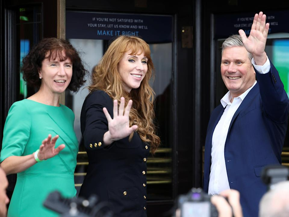Labour leader Sir Keir Starmer arrives at the party's conference in Brighton alongside deputy leader Angela Rayner (middle) and party chair Anneliese Dodds (left) (Henry Nicholls/Reuters)