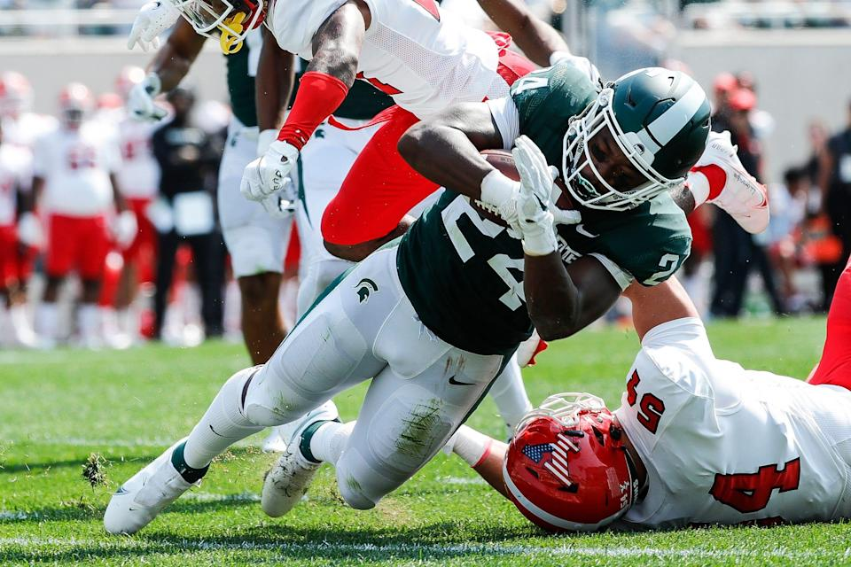 Michigan State running back Elijah Collins (24) runs for a touchdown against Youngstown State during the first half at Spartan Stadium in East Lansing on Saturday, Sept. 11, 2021.