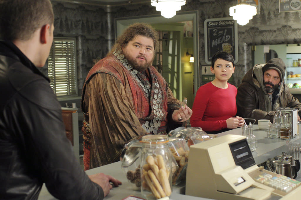 """Tiny"" - Kidnapped and brought to Storybrooke by Cora, the Giant (Jorge Garcia) unleashes his vengeance on the town when a case of mistaken identity leads him to try and settle an old score with David; Mr. Gold, accompanied by Emma and Henry, attempts to depart Storybrooke - hoping to keep his memory intact when he crosses the town line -- and heads to the airport in search of his son Bae; and Greg (Ethan Embry) questions Belle as to what she saw on the night of his car accident. Meanwhile, in the fairytale land that was and against his brothers' wishes, Anton, the Giant, climbs down the beanstalk and attempts to befriend some humans - whose intentions may not be so noble -- on ""Once Upon a Time."""