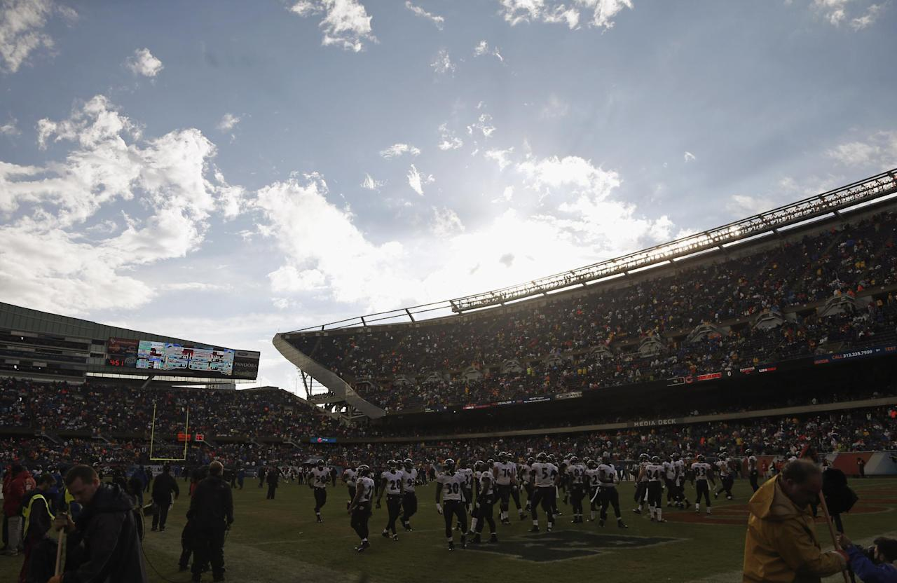 Baltimore Ravens players take the field to resume play after a severe storm blew through Soldier Field and suspended play in the first half of an NFL football game against the Chicago Bears, Sunday, Nov. 17, 2013, in Chicago. (AP Photo/Charles Rex Arbogast)