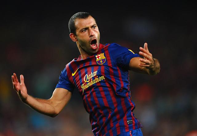 BARCELONA, SPAIN - AUGUST 17: Javier Mascherano of Barcelona celebrates victory in the Super Cup second leg match between Barcelona and Real Madrid at Nou Camp on August 17, 2011 in Barcelona, Spain. (Photo by Laurence Griffiths/Getty Images)