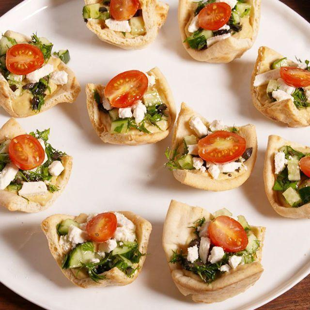 """<p>Put your muffin tin to use with this ridiculously easy snack!</p><p>Get the <a href=""""https://www.delish.com/uk/cooking/recipes/a35445213/greek-pita-cups-recipe/"""" rel=""""nofollow noopener"""" target=""""_blank"""" data-ylk=""""slk:Greek Pitta Cups"""" class=""""link rapid-noclick-resp"""">Greek Pitta Cups</a> recipe.</p>"""
