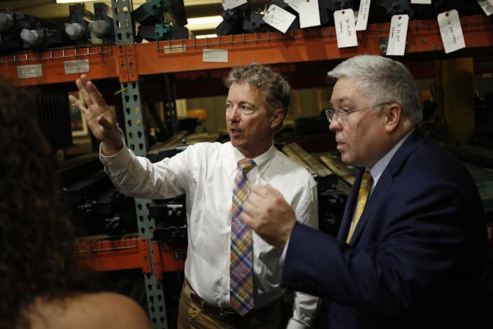 Sen. Rand Paul, R-Ky., left, talks with Attorney General Patrick Morrisey, the Republican U.S. Senate candidate from West Virginia, during a campaign event in Huntington, W.Va. on May 3. (Photo: Luke Sharrett/Bloomberg via Getty Images