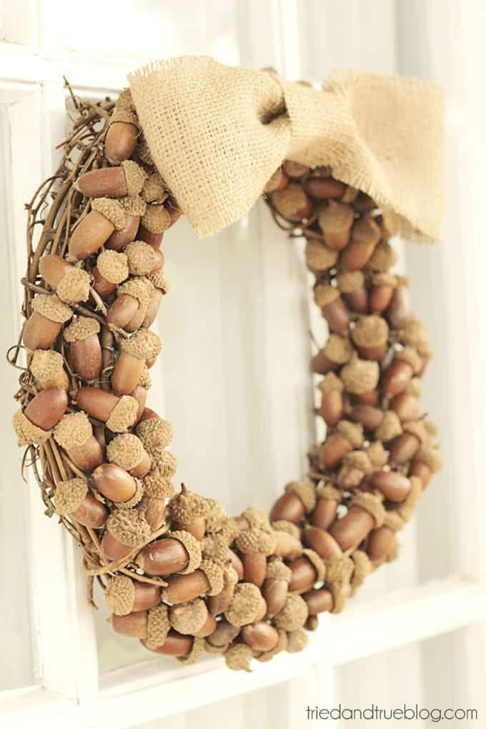"""<p>This creative wreath is easier to make than it looks, and its neutral colors will match any door. </p><p><strong>Get the tutorial at <a href=""""https://www.triedandtrueblog.com/fall-wreaths-with-acorns/"""" rel=""""nofollow noopener"""" target=""""_blank"""" data-ylk=""""slk:Tried and True"""" class=""""link rapid-noclick-resp"""">Tried and True</a>.</strong> </p>"""