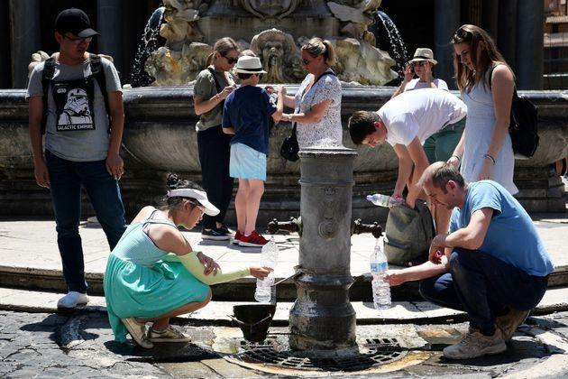 Tourists drink and fill their bottle from a public fountain to refresh themselves during an unusually early summer heatwave on June 24, 2019 in Rome. - Fans flew off store shelves and public fountains offered relief from the heat as temperatures soared in Europe on June 24, with officials urging vigilance ahead of even hotter conditions forecast later in the week. Meteorologists blamed a blast of torrid air from the Sahara for the unusually early summer heatwave, which could send thermometers up to 40 degrees Celsius (104 Fahrenheit) across large swathes of the continent. (Photo by Alberto PIZZOLI / AFP)        (Photo credit should read ALBERTO PIZZOLI/AFP via Getty Images) (Photo: ALBERTO PIZZOLI via Getty Images)