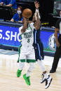 Boston Celtics guard Kemba Walker (8) shoots as Dallas Mavericks guard Josh Richardson defends during the first half of an NBA basketball game in Dallas, Tuesday, Feb. 23, 2021. (AP Photo/Sam Hodde)