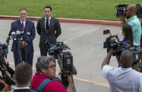 Victor Hugo Cuevas, a 26-year-old linked to a missing tiger named India, and his attorney Michael Elliott, left, talk to reporters before entering Fort Bend County Justice Center for a bond revocation hearing on a separate murder charge, on Friday, May 14, 2021, in Richmond, Texas. (Godofredo A. Vásquez/Houston Chronicle via AP)