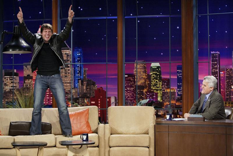 """Tom Cruise stands on a couch, something he likes to do, during an interview on """"The Tonight Show with Jay Leno"""" in 2005. (Photo: NBC via Getty Images)"""