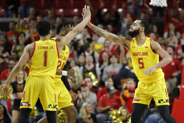 Maryland guard Eric Ayala (5) is congratulated by guard Anthony Cowan Jr. (1) and forward Donta Scott (24) after scoring a 3-point shot against Nebraska during the second half of an NCAA college basketball game, Tuesday, Feb. 11, 2020, in College Park, Md. Maryland won 72-70. (AP Photo/Julio Cortez)