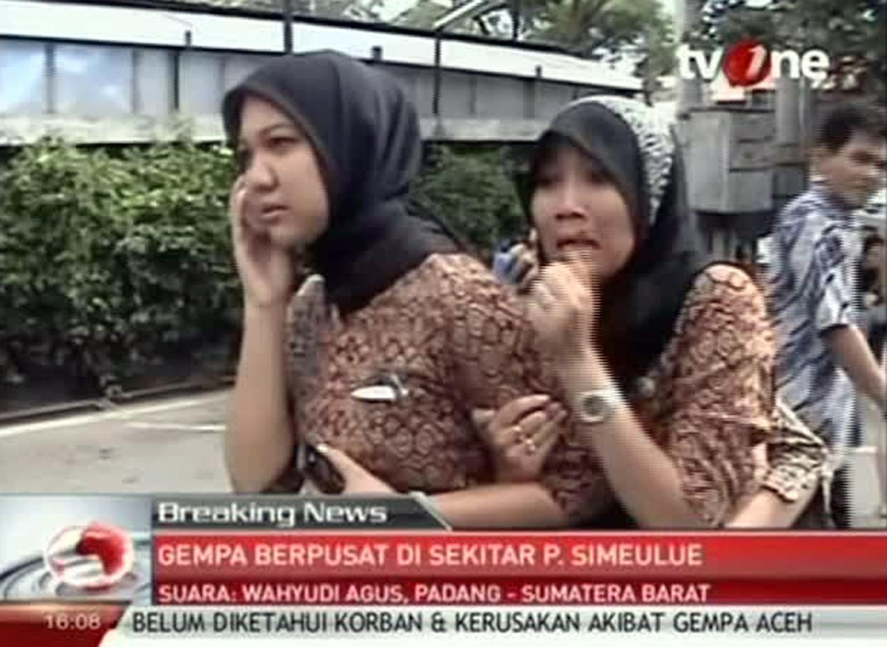 In this image made from Indonesian television TV One, two women react on a street shortly after they ran out from a building when a strong earthquake hit in Aceh in Indonesia, Wednesday, April 11, 2012. A tsunami watch was issued for countries across the Indian Ocean after a large earthquake hit waters off Indonesia on Wednesday, triggering widespread panic as residents along coastlines fled to high ground in cars and on the backs of motorcycles. (AP Photo/TV One via AP Video) INDONESIA OUT