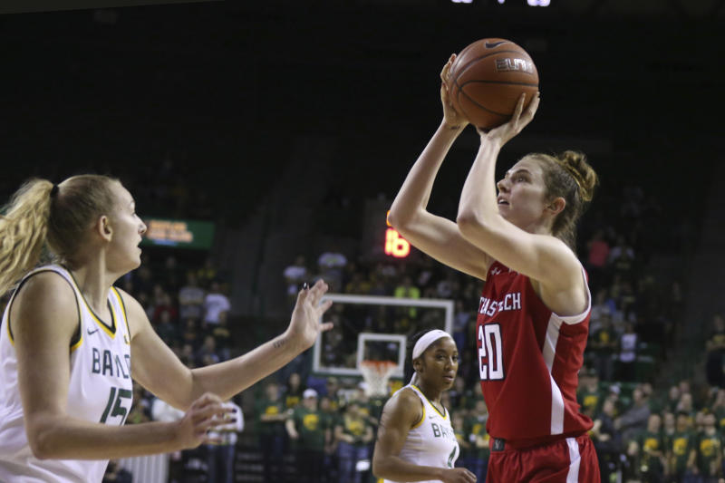 Texas Tech forward Brittany Brewer, right, scores over Baylor forward Lauren Cox, left, in the first half of an NCAA college basketball game, Saturday, Jan. 25, 2020, in Waco Texas. (AP Photo/Rod Aydelotte)