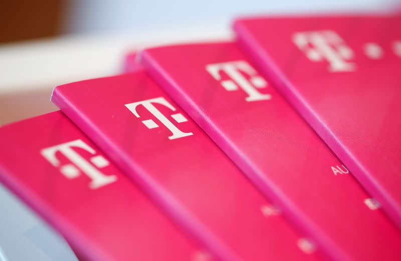 FILE PHOTO: Brochures with the logo of Deutsche Telekom AG are pictured at the shop in the headquarters of German telecommunications giant in Bonn