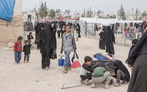 Women and children walk through the section for foreign families at a camp for people who lived under ISIS and are now displaced, in Al Hol, near Hasakeh in Syria - Credit: Sam Tarling/The Telegraph