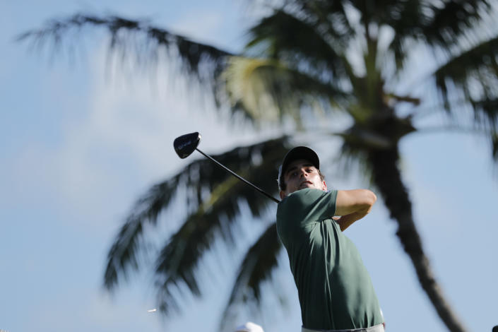 Joaquin Niemann, of Chile, follows through on his shot from the 14th tee box during the first round of the Sony Open golf tournament Thursday, Jan. 14, 2021, at Waialae Country Club in Honolulu. (AP Photo/Jamm Aquino)