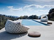 """<p>This Patricia Urquiola design is the absolute height of poolside chic. Interlaced in a contemporary oversized pattern inspired by Vienna straw, the water repellent seat fabric of this luxurious sun lounger is extremely comfortable, and the option of a sun shade ensures you'll never overheat. £7,343, <a href=""""https://chaplins.co.uk/shop/bb-italia-canasta-outdoor-circular-armchair-with-canopy.html?gclid=Cj0KCQjwh_eFBhDZARIsALHjIKfZiM_1Ldl4khHF0vrOICxaHH5i9RUj_itVdKL4l4f7g7mjlEDjInMaAl0BEALw_wcB"""" rel=""""nofollow noopener"""" target=""""_blank"""" data-ylk=""""slk:chaplins.co.uk"""" class=""""link rapid-noclick-resp"""">chaplins.co.uk</a></p>"""