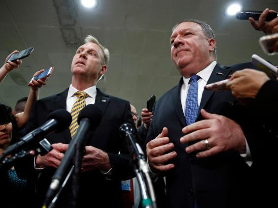 Patrick Shanahan, left, and Mike Pompeo speak after a classified briefing for members of Congress on Iran (AP)