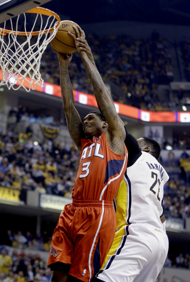 Atlanta Hawks' Louis Williams (3) goes up for a shot as Indiana Pacers' Ian Mahinmi, right, defends during the first half in Game 5 of an opening-round NBA basketball playoff series Monday, April 28, 2014, in Indianapolis. (AP Photo/Darron Cummings)