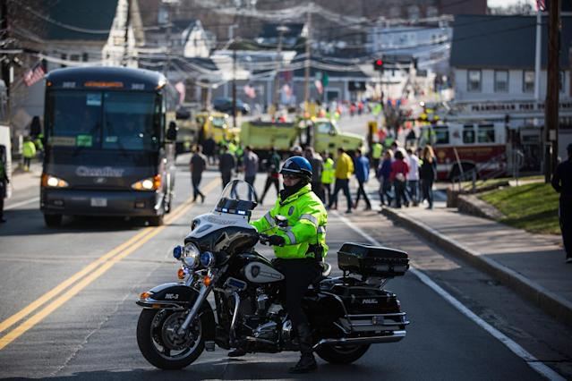 HOPKINGTON, MA - APRIL 21: A Massachusetts State Police officer stands guard prior to the start of the Boston Marathon on April 21, 2014 in Hopkington, Massachusetts. Today marks the 118th Boston Marathon; security presence has been increased this year, due to two bombs that were detonated at the finish line last year, killing three people and injuring more than 260 others. (Photo by Andrew Burton/Getty Images)