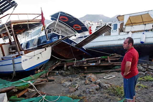 <p>A man looks at boats that crashed on top of each other in the harbor in Bodrum, in the overnight earthquake is seen in Bodrum, Turkey, Friday, July 21, 2017. (Photo: DHA-Depo Photos via AP) </p>