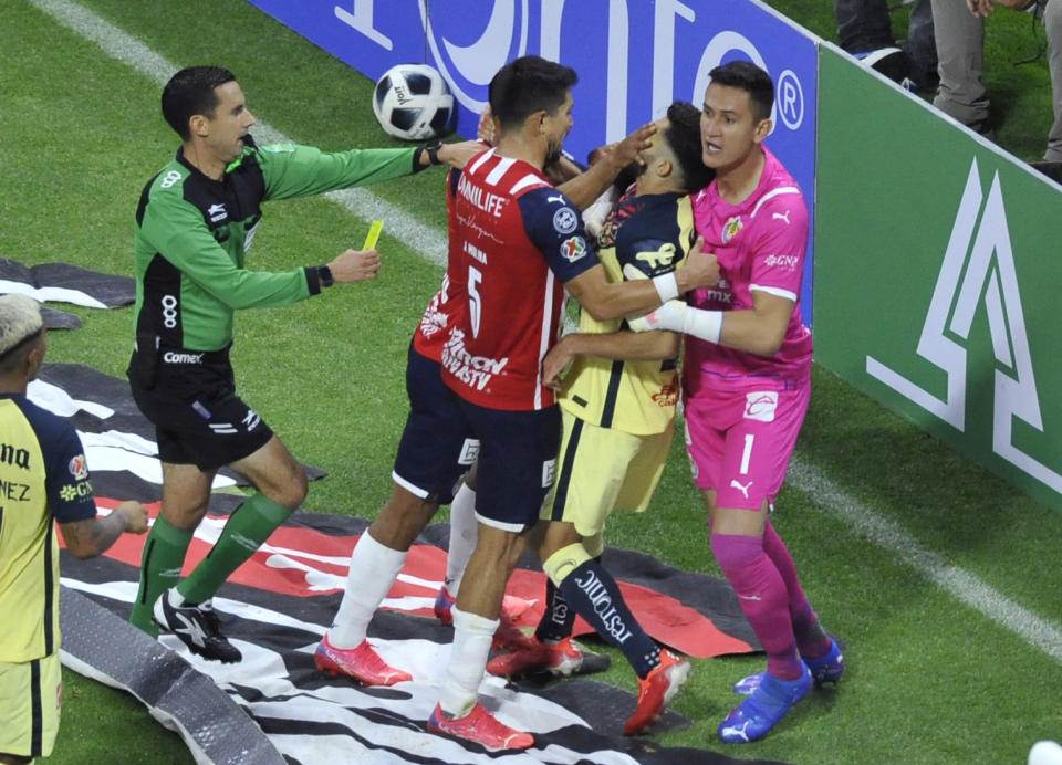 Henry Martin (2nd R) of America fights with Jesus Molina (5) of Guadalajara during their Mexican Apertura tournament football match at the Aztec stadium, in Mexico City on September 25, 2021. (Photo by CLAUDIO CRUZ / AFP) (Photo by CLAUDIO CRUZ/AFP via Getty Images)