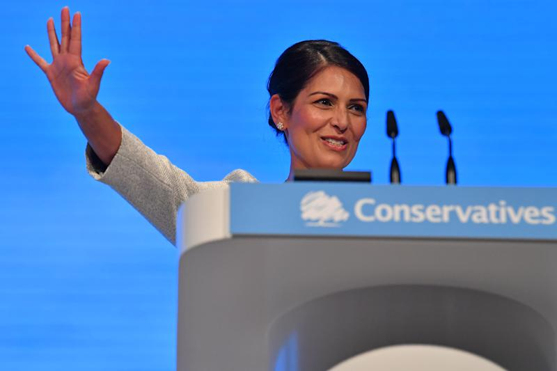"Britain's Home Secretary Priti Patel gestures after delivering her keynote speech on the third day of the annual Conservative Party conference at the Manchester Central convention complex, in Manchester, north-west England on October 1, 2019. - Britain will be tabling its new proposals on a Brexit deal ""very soon"", Prime Minister Boris Johnson said Tuesday, while distancing himself from a leaked plan about the Irish border. ""We are going to make a very good offer. We will be tabling it formally very soon,"" Johnson told BBC television from Manchester, where he is holding his Conservative party's conference. (Photo by Ben STANSALL / AFP) (Photo credit should read BEN STANSALL/AFP via Getty Images)"