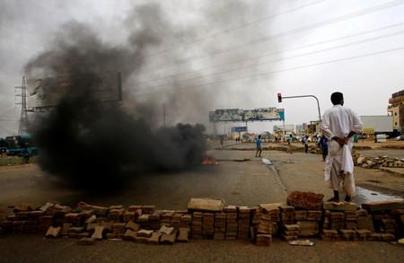 Sudan's military chief says he's ready to resume talks as death toll rises to 60