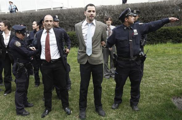 Occupy Wall Street movement supporters are arrested on the grounds of the UN as they protest climate issues in New York, March 24, 2012.