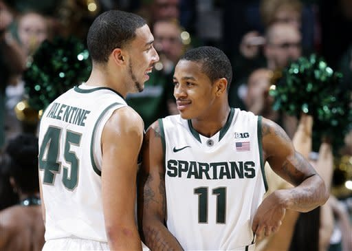 Michigan State's Keith Appling (11) and Denzel Valentine celebrate during the second half of an NCAA college basketball game against Wisconsin, Thursday, March 7, 2013, in East Lansing, Mich. Appling led Michigan State with 19 points in a 58-43 win. (AP Photo/Al Goldis)