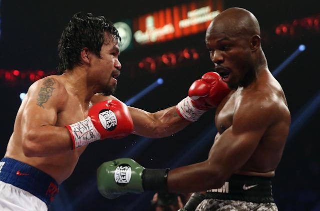 LAS VEGAS, NV - APRIL 12: Manny Pacquiao throws a left hand at Timothy Bradley at the MGM Grand Garden Arena on April 12, 2014 in Las Vegas, Nevada. (Photo by Jeff Gross/Getty Images)