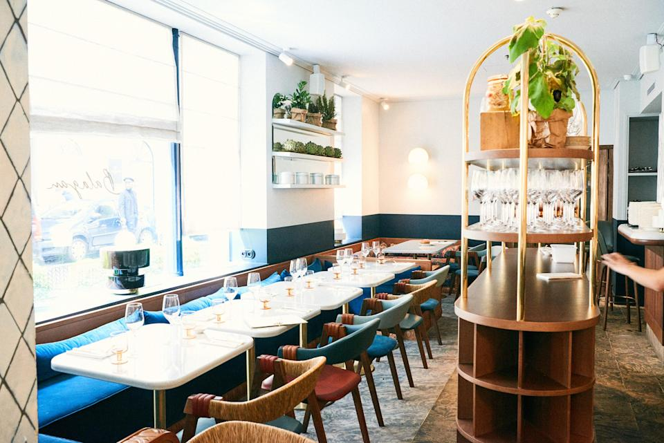 """<p><strong>Tell us about your first impressions when you arrived.</strong><br> Despite its prestigious location just off the well-heeled rue Saint-Honoré in the 1st arrondissement—the Madison Avenue of Paris, if you will—everything about the inside of this new Middle Eastern hot spot screams Spring Street and West Broadway in NYC. For starters, it's far bigger than most Parisian restaurants and there's a huge wrap-around bar-slash-open-kitchen where Israeli chefs Assaf Granit and Uni Navon spend the evening hollering out a """"mazel tov!"""" or an """"ohlala!"""" as they top the world's creamiest chicken liver with a poached egg (among other spiced-up delicacies). Then there's the room, a contemporary riff on '40s French by Dorothée Meilichzon (of Henrietta restaurant in London and the 9th arrondissement's Grand Pigalle Hotel, among others): retro sconces, triangular-shaped subway tiles, fifty shades of blue, and golden mirrors.</p> <p><strong>What was the crowd like?</strong><br> There's a definite classiness to the crowd (potentially because of its high prices and tony address), but everyone is out to have a good time and many have come because they're expecting the same lively environment and tasty food that Assaf Granit and Uni Navon are known to create at either Machneyuda in Jerusalem or Palomar in London. (And they won't be disappointed.) Women may be carrying Chanel, but there may be a tattoo beneath their silk Cacharel blouses, and their boyfriends, much like the staff, are bearded and pierced, too.</p> <p><strong>What should we be drinking?</strong><br> The Experimental Cocktail Group handles the menu here, so it's definitely worth ordering a tipple to start (or come solely for a drink) in the pink-hued bar immediately opposite the entrance off rue d'Alger. Drinks like the Dill Dong, with white vermouth, apple liquor, dill, lemon, and soda, are even more provocative than their name. Nice wines as well.</p> <p><strong>Main event: the food. Give us the lowdown—especiall"""