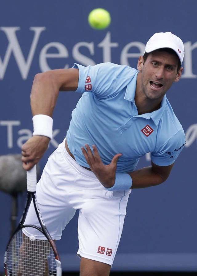 Novak Djokovic, from Serbia, serves against Tommy Robredo, from Spain, during a match at the Western & Southern Open tennis tournament, Thursday, Aug. 14, 2014, in Mason, Ohio. (AP Photo/Al Behrman)