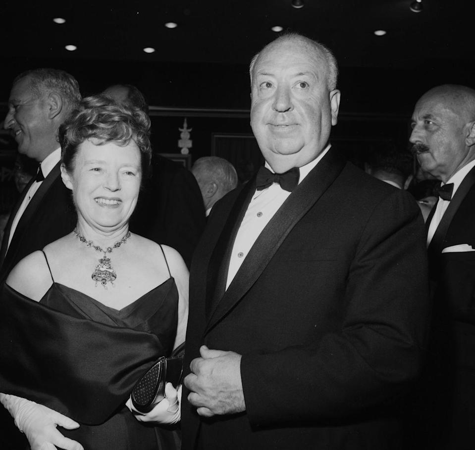 <p>Acclaimed <em>Psycho</em> director Alfred Hitchcock and his wife Alma Reville attend a Los Angeles film premiere in 1952.</p>