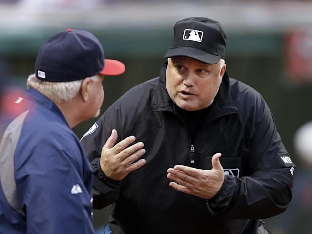 Umpire crew chief Brian O'Nora explains why a call was upheld on review to Minnesota Twins manager Ron Gardenhire in the third inning of a baseball game Cleveland Indians Wednesday, May 7, 2014, in Cleveland. Indians' Michael Brantley was called safe at second base on a bases-loaded double that drove in two runs. (AP Photo/Mark Duncan)