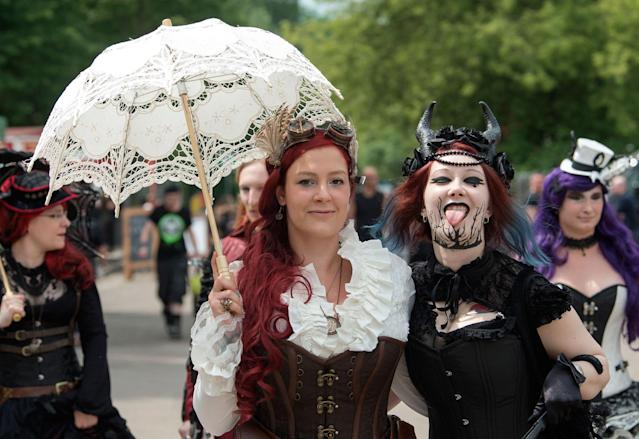 <p>Participants in fancy costumes attend the Wave Gothic Festival (WGT) in Leipzig, Germany, Saturday, June 3, 2017. (AP Photo/Jens Meyer) </p>